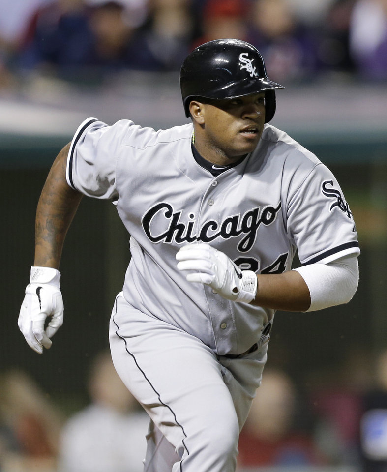 Photo - Chicago White Sox's Dayan Viciedo runs out a triple after hitting off Cleveland Indians relief pitcher Chris Perez in the ninth inning of a baseball game, Monday, July 29, 2013, in Cleveland. The Indians won 3-2. (AP Photo/Tony Dejak)