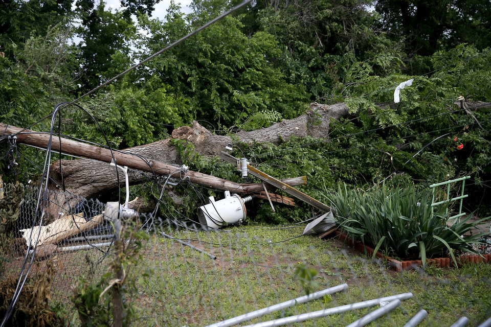 Photo - Juan Luna's backyard is pictured near 21st and McKinley after an apparent tornado moved through the area in Oklahoma City, Sunday, May 26, 2019. Luna said the sirens sounded and it instantly became windy. He stood next to an interior wall with his 12 year old daughter.  [Sarah Phipps/The Oklahoman]