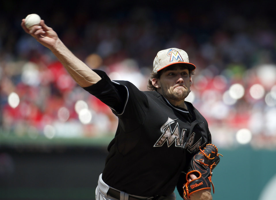 Photo - Miami Marlins starting pitcher Nathan Eovaldi (24) throws during the fifth inning of a baseball game against the Washington Nationals at Nationals Park Monday, May 26, 2014, in Washington. (AP Photo/Alex Brandon)