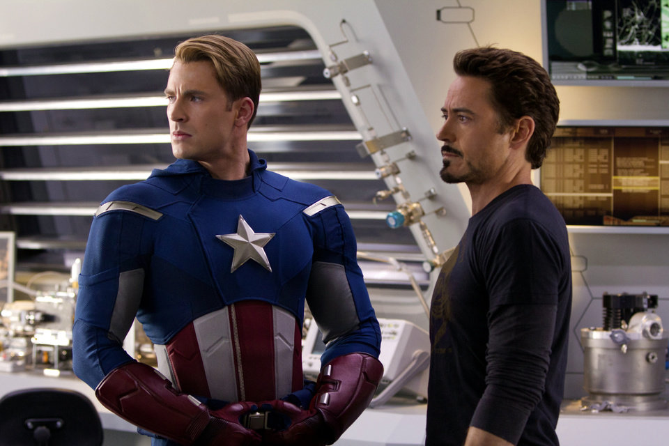 Photo -   In this film image released by Disney, Chris Evans, portraying Captain America, left, and Robert Downey Jr., portraying Tony Stark, are shown in a scene from