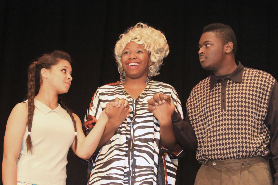 """Whitney Cravens, as Little Inez, Alexis Ward, as Motormouth Maybelle, and C.J. Walker, as Seaweed, rehearse """"Hairspray."""""""