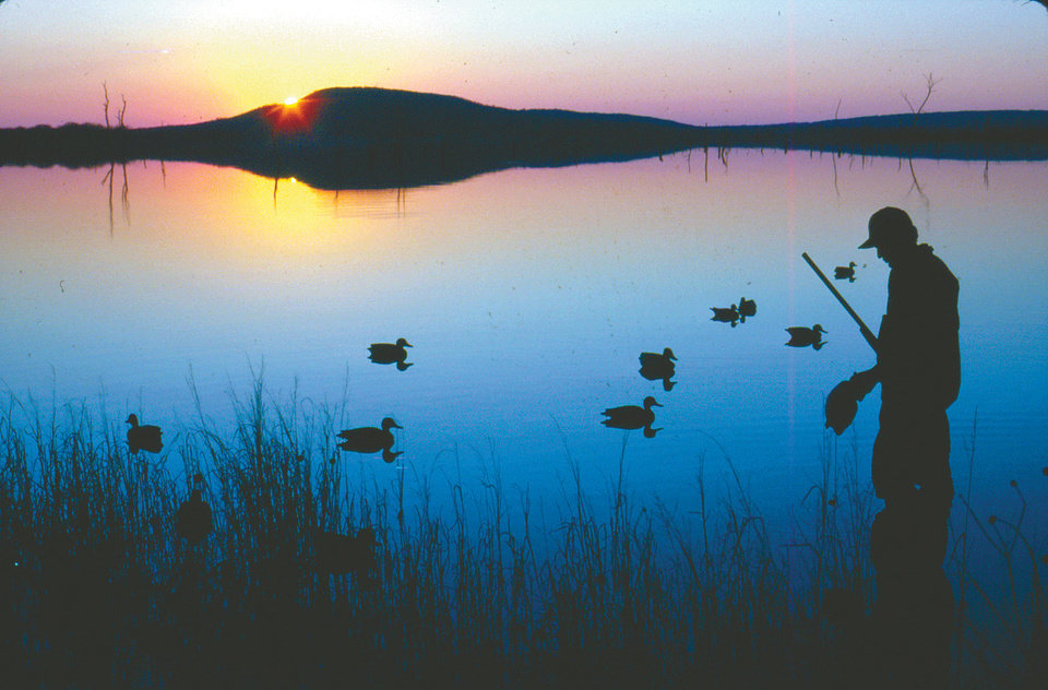 "Photo -  DUCK HUNTING: Oklahoma duck hunters will have a longer split between the first and second halves of the season this year. Instead of the usual five-day split, the Oklahoma Wildlife Conservation Commission on Tuesday approved a 12-day break to give the duck populations more time to rebuild in the state. ""A five-day split basically did nothing,"" said Greg Duffy, director of the Wildlife Department. ORG XMIT: 0909011629305631"