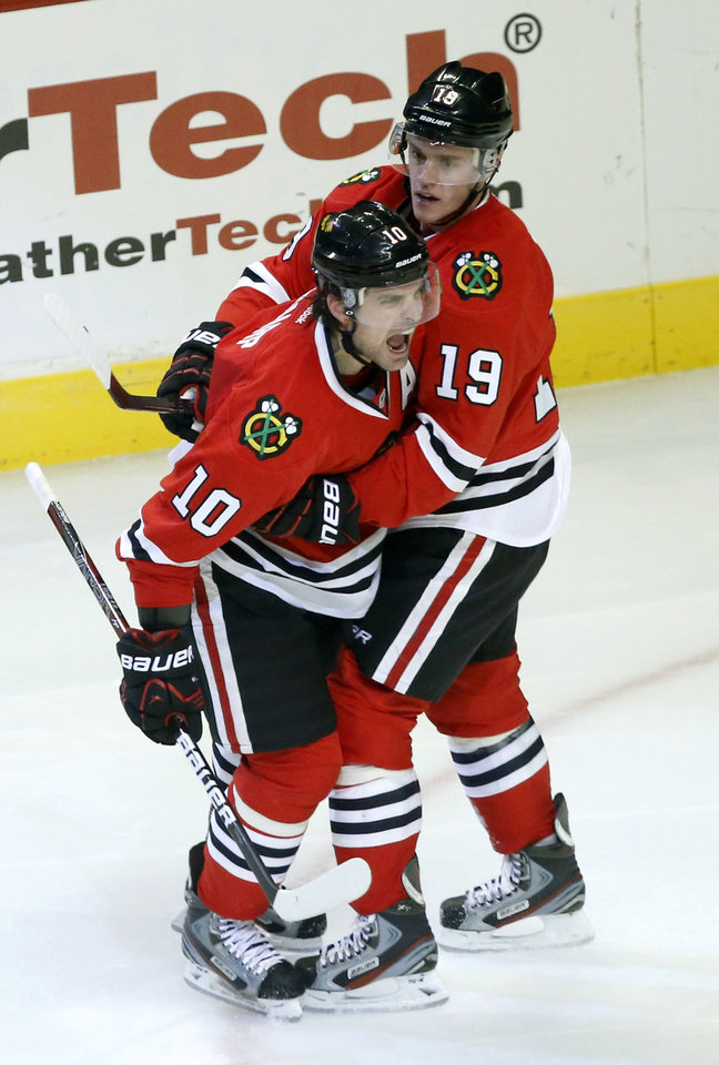 Chicago Blackhawks center Patrick Sharp (10) celebrates his goal with Jonathan Toews (19) during the second period of an NHL hockey game against the Vancouver Canucks Tuesday, Feb. 19, 2013 in Chicago. (AP Photo/Charles Rex Arbogast)