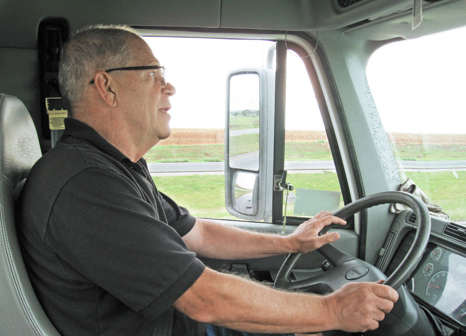 Dwayne Hickman, who drives a truck for the Regional Food Bank of Oklahoma, is shown while taking a load of food to Cordell and Hobart. PHOTO BY BRYAN PAINTER, THE OKLAHOMAN