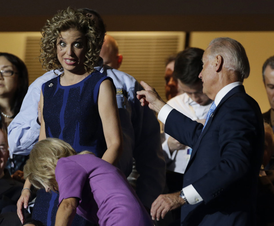 Photo - Vice President Joe Biden chats with Democratic National Committee Chairwoman Rep. Debbie Wasserman Schultz, from Florida, during the Democratic National Convention in Charlotte, N.C., on Wednesday, Sept. 5, 2012. (AP Photo/Charlie Neibergall)  ORG XMIT: DNC180
