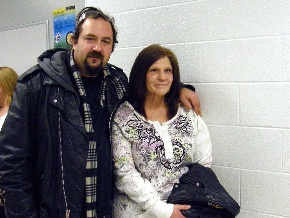 Photo - Jason and Linda Popielarski, of Tecumseh, hope to see a doctor about Linda's sinus infection.
