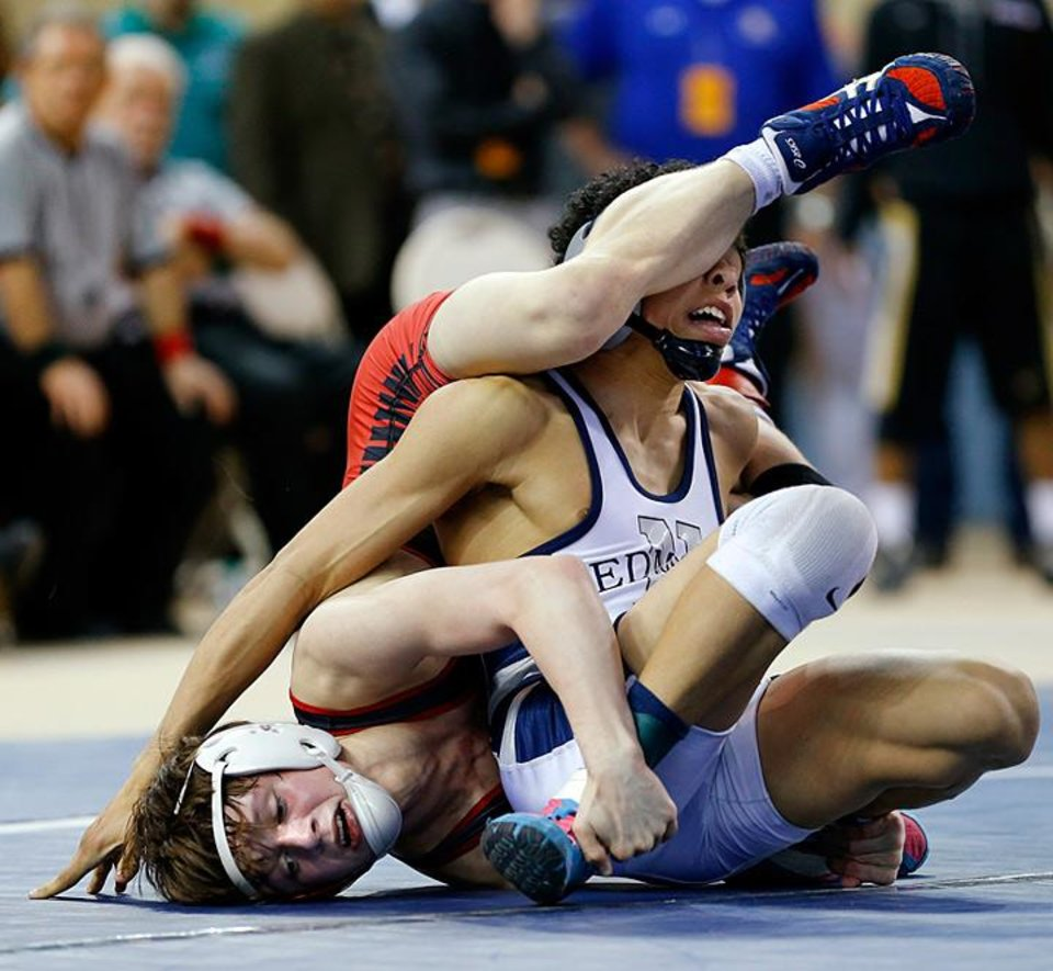 Edmond North's Jordan Prince, left, wrestles Westmoore's Dalton Duffield in the Class 6A 106-pound championship match during the state wrestling championships at the State Fair Arena in Oklahoma City, Saturday, Feb. 23, 2013. Photo by Bryan Terry, The Oklahoman