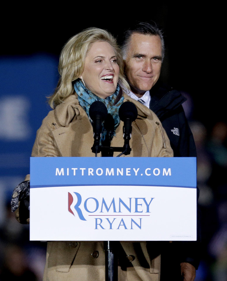 Republican presidential candidate, former Massachusetts Gov. Mitt Romney, right, is joined on stage by his wife Ann as they appear at a campaign event at Shady Brook Farm, Sunday, Nov. 4, 2012, in Morrisville, Penn. (AP Photo/David Goldman)