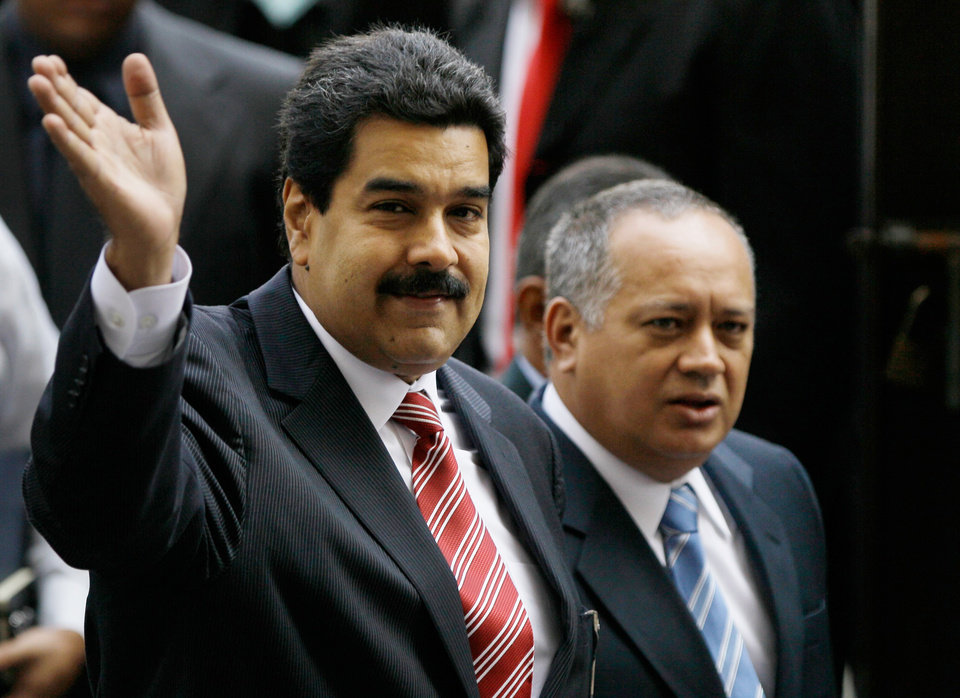 Venezuela\'s Vice President Nicolas Maduro, left, and National Assembly President Diosdado Cabello greet the media as they arrive to the Supreme Court for a special session marking the start of the judicial year in Caracas, Venezuela, Monday, Jan. 21, 2013. Maduro said Sunday he\'s optimistic that President Hugo Chavez will soon return to Venezuela following cancer-related surgery in Cuba. (AP Photo/Fernando Llano)