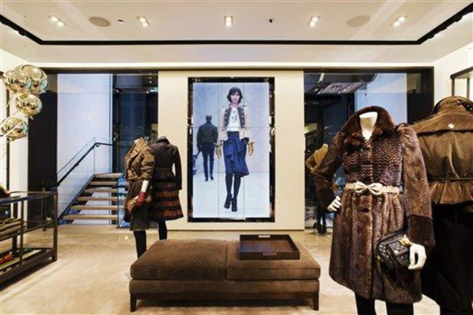 This undated publicity photo provided by BURBERRY shows an interior view of the BURBERRY PRORSUM section of the new BURBERRY Flagship store opened in November 2012 on Michigan Avenue in Chicago. BURBERRY has been known for generations for its signature check pattern and trenchcoat. The company has monthly updates at Burberry.com, where CEO, Angela Ahrendts said, more people visit every week than walk into all the brand\'s stores around the world combined. (AP Photo/BURBERRY)