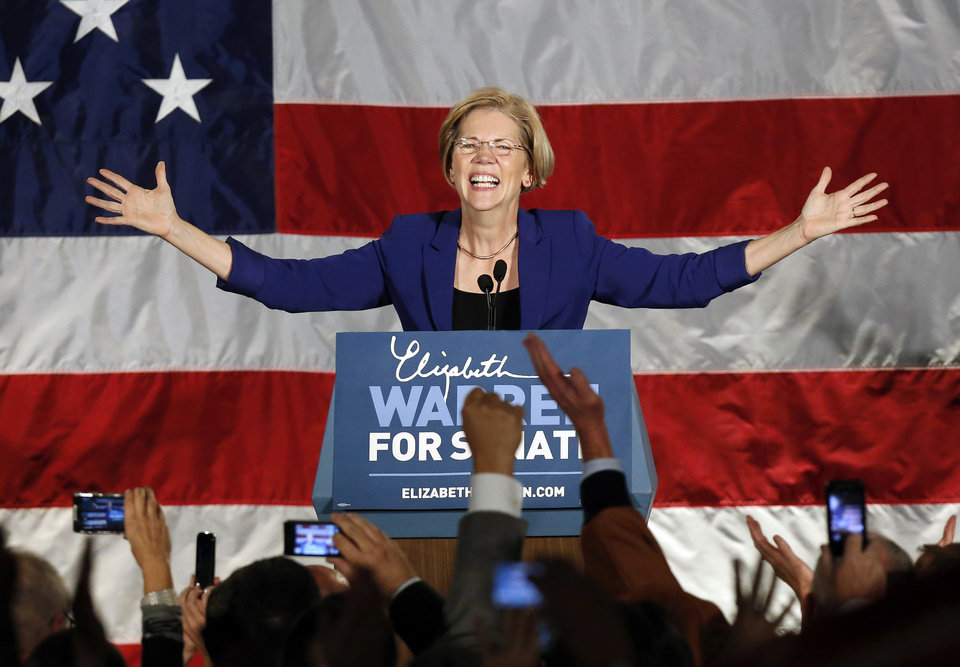 FILE - In this Nov. 6, 2012 file photo, Democrat Elizabeth Warren takes the stage after defeating incumbent GOP Sen. Scott Brown in the Massachusetts Senate race, during an election night rally at the Fairmont Copley Plaza hotel in Boston. Warren's election was one of the state's top stories in 2012. (AP Photo/Michael Dwyer, File)
