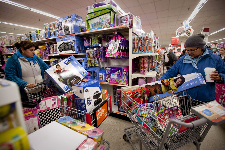 Photo -   IMAGE DISTRIBUTED FOR KMART - Customers Rocio Garcia, left, and Maria Chavez, both from Chicago, shop the Kmart toy department for doorbuster deals at the Addison Street store in Chicago on Thanksgiving Thursday, Nov. 22, 2012. Kmart was the first major retailer nationwide to kick off pre-Black Friday shopping on Thanksgiving morning at 6 a.m. (John Konstantaras/AP Images for Kmart)