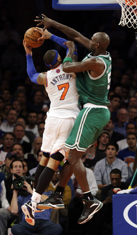 Photo - Boston Celtics forward Kevin Garnett (5) blocks a shot by New York Knicks forward Carmelo Anthony (7) in the second half of their NBA basketball game at Madison Square Garden in New York, Monday, Jan. 7, 2013. The Celtics won 102-96. (AP Photo/Kathy Willens)