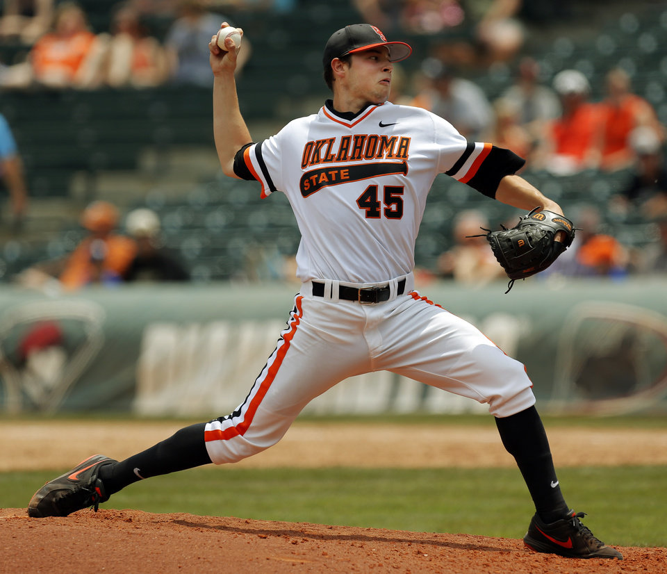 Photo - OSU's Thomas Hatch (45) pitches during a college baseball game between Texas and Oklahoma State in the Big 12 baseball tournament at the Chickasaw Bricktown Ballpark in Oklahoma City,  Saturday, May 24, 2014. OSU won 3-1 to force an elimination game. Photo by Nate Billings, The Oklahoman
