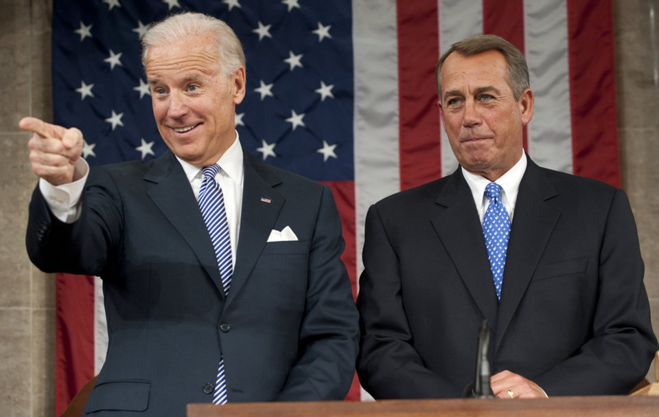 Photo - Vice President Joe Biden and House Speaker John Boehner are seen before President Barack Obama's State of the Union address in front of a joint session of Congress Tuesday, Jan. 24, 2012, at the Capitol in Washington. (AP Photo/Saul Loeb, Pool) ORG XMIT: WX177