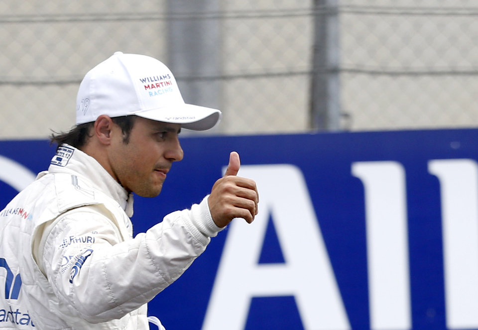 Photo - Williams driver Felipe Massa of Brazil celebrates after the qualifying for Sunday's Austrian Grand Prix at the Spielberg track, Austria, Saturday, June 21, 2014.  Massa will start from the pole position.  (AP Photo/Darko Vojinovic)