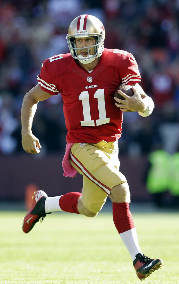 San Francisco 49ers quarterback Alex Smith (11) runs against the Buffalo Bills during the second half of an NFL football game in San Francisco, Sunday, Oct. 7, 2012. The 49ers won 45-3. (AP Photo/Tony Avelar)