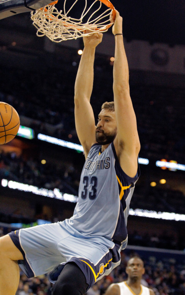 Photo - Memphis Grizzlies center Marc Gasol (33) dunks against the New Orleans Pelicans in the first half of an NBA basketball game in New Orleans, Wednesday, March 12, 2014. (AP Photo/Scott Threlkeld)