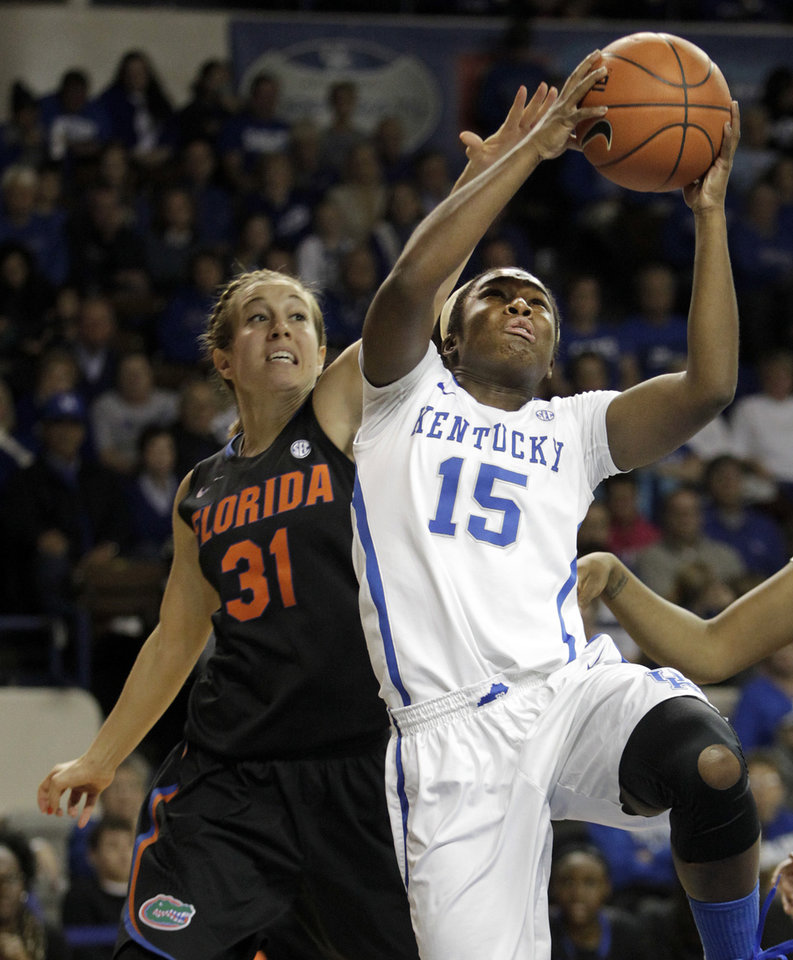 Photo - Kentucky's Linnae Harper (15) shoots under pressure from Florida's Lily Svete (31) during the first half of an NCAA college basketball game on Sunday, Jan. 5, 2014, in Lexington, Ky. (AP Photo/James Crisp)