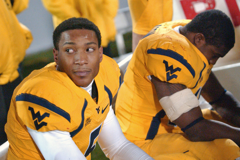 Photo - University of West Virginia's Pat White, left, and Steve Slaton, right, sit on the bench late in the second half during a 13-9 loss to University of Pittsburgh in a college football game Saturday, Dec. 1, 2007 in Morgantown, W.Va. (AP Photo/Jeff Gentner)  ORG XMIT: WVJG119