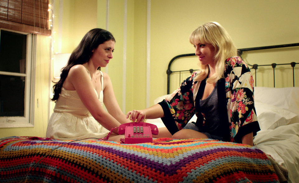 Photo -   This film image released by Focus Features shows Lauren Miller as Lauren, left, and Ari Graynor as Katie in a scene from