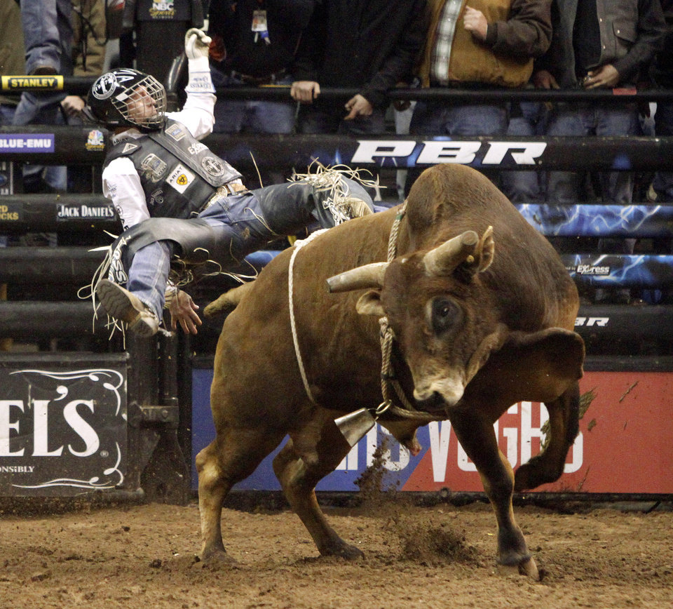 Cord McCoy flies off Wild Cherry during the Winstar World Casino Invitational PBR tour stop at the Chesapeake Energy Arena on Saturday, Feb. 11, 2012. Photo by Bryan Terry, The Oklahoman
