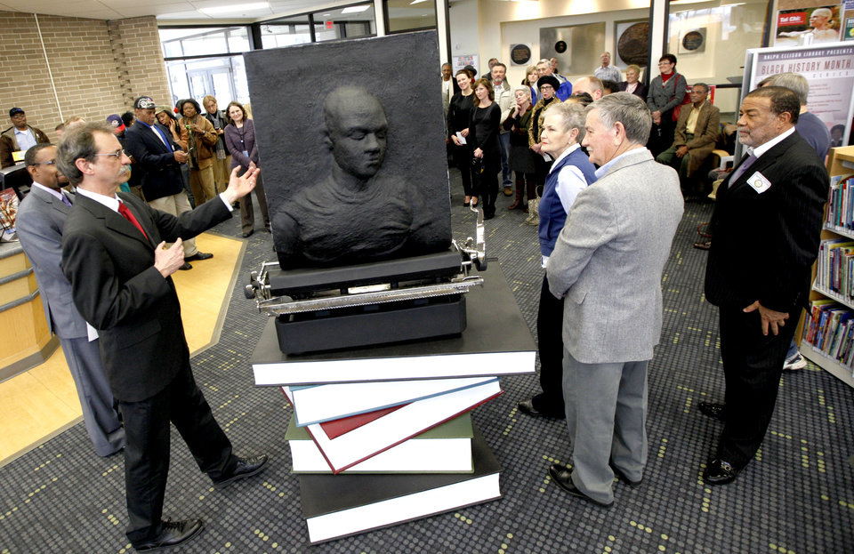 Artist David Phelps talks about his statue statue The Invisible Royalty at the Ralph Ellison Library in Oklahoma City, Thursday, Feb. 9, 2012. Photo by Sarah Phipps, The Oklahoman