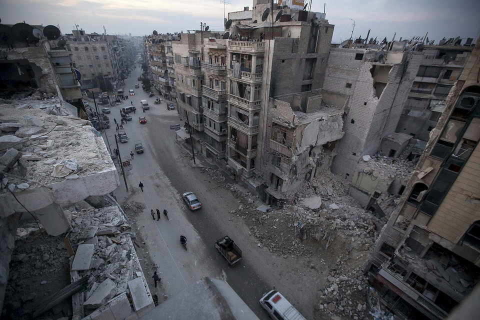In this Thursday, Nov. 29, 2012 photo, destroyed buildings, including Dar Al-Shifa hospital, are seen on Sa'ar street after airstrikes targeted the area in Aleppo, Syria. (AP Photo/Narciso Contreras)