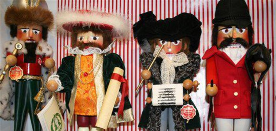 Photo - This Nov. 11, 2012 photo shows a variety of Nutcracker dolls at The Whitney Shop In New Canaan, Conn. The wooden dolls, many of which will really crack your walnuts and macadamias, are increasingly popular in holiday decor. The classic Nutcracker nutcracker, a soldier with his sword in hand and prominent moustache, comes from the early 19th-century tale
