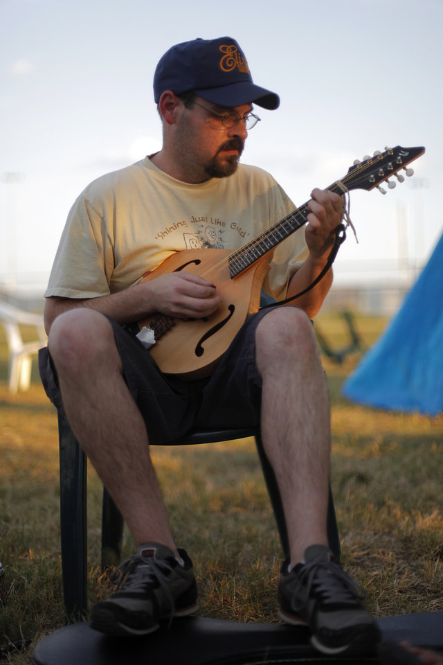Jeff Clanton plays mandolin near his camp during the Woody Guthrie Folk Festival in Okemah, Okla., Thursday, July 12, 2012.  Photo by Garett Fisbeck, The Oklahoman