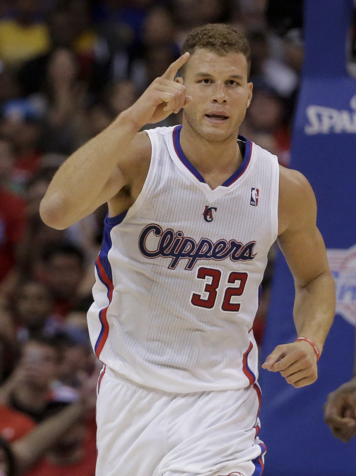 Photo - Los Angeles Clippers forward Blake Griffin celebrate a basket against the Golden State Warriors during the second half in Game 2 of an opening-round NBA basketball playoff series in Los Angeles, Monday, April 21, 2014. (AP Photo/Chris Carlson)