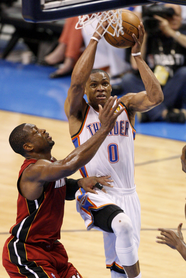 Oklahoma City's Russell Westbrook (0) goes to the basket beside Miami's Dwyane Wade (3) during Game 1 of the NBA Finals between the Oklahoma City Thunder and the Miami Heat at Chesapeake Energy Arena in Oklahoma City, Tuesday, June 12, 2012. Photo by Nate Billings, The Oklahoman