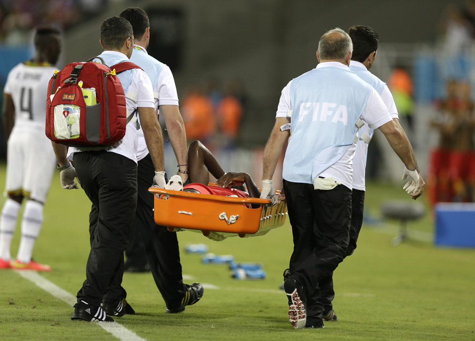 Photo - United States' Jozy Altidore is carried from the pitch on a stretcher after pulling up injured during the group G World Cup soccer match between Ghana and the United States at the Arena das Dunas in Natal, Brazil, Monday, June 16, 2014. (AP Photo/Ricardo Mazalan)
