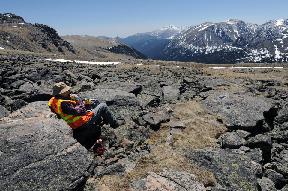 Photo - FILE - In this May 14 2012 file photo, Road work volunteer Peter Plaut enjoys the view from just off of Trail Ridge Road outside Estes Park, Colo. Two fatal lightning strikes on consecutive days in July 2014 pinpoint dangers not always apparent to visitors to the 11,000-foot exposed high country of Rocky Mountain National Park. Afternoon storms visible miles away arrive overhead suddenly. (AP Photo/The Daily Camera, Walt Hester, file)