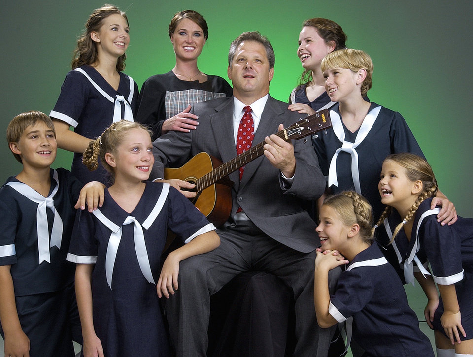 Photo - OKLAHOMA CITY, THURSDAY, Aug. 19, 2004. Jewel Box cast of the Sound of Music pose for a portrait. Pictured are back row standing left to right, Danielle Schlegle, Makenna Smith (who plays Maria), Emiley Schoeb (both names are cq), and Tait Nelson.  Jeff Perkins, who plays Capt. von Trapp, is shown center. Front row left to right is Weston Waugh, Adrian Bumpas, Maggie Free and Hannah Freeman. Staff Photo by Bill Waugh.