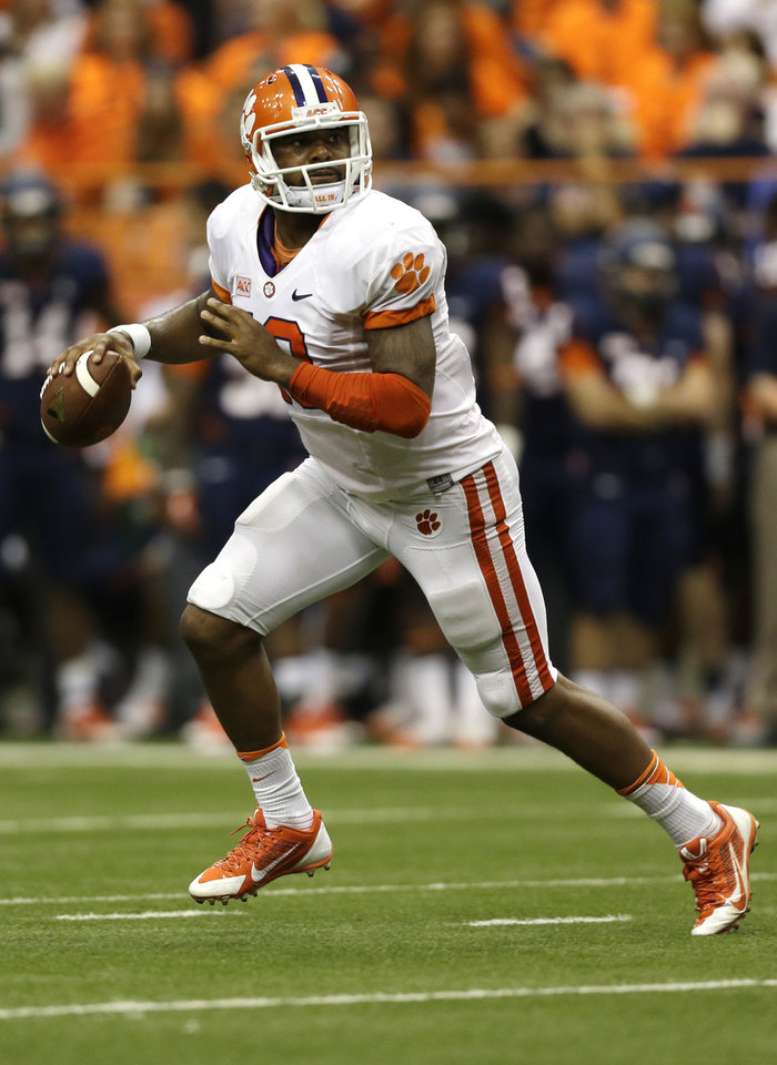 Photo - Clemson quarterback Tajh Boyd (10) looks to pass against Syracuse during the first half of an NCAA college football game on Saturday, Oct. 5, 2013, in Syracuse, N.Y. (AP Photo/Mike Groll)