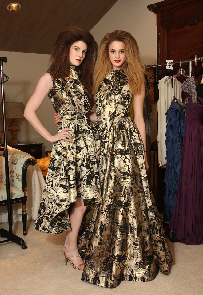 "Models Alyssa Siler and Allie Ayers  show off dresses from South African designers in the dressing room before a fashion show at the ""A Night for Africa"" fundraiser. PHOTO BY DAVID FAYTINGER, FOR THE OKLAHOMAN. <strong></strong>"