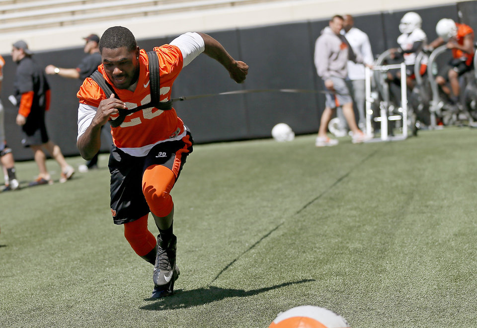 Photo - OSU's Desmond Roland trains during Oklahoma State's Orange Blitz football practice at Boone Pickens Stadium in Stillwater, Okla., Saturday, April 5, 2014.