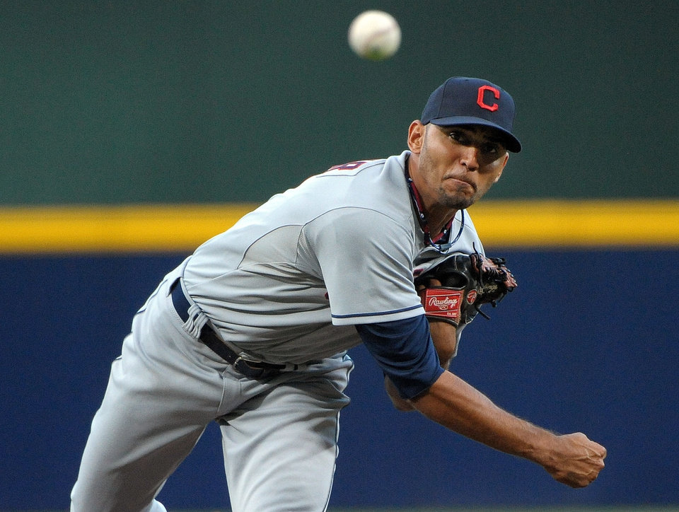 Photo - Cleveland Indians pitcher Danny Salazar delivers to the Atlanta Braves during the first inning of a baseball game at Turner Field, Tuesday, Aug. 27, 2013, in Atlanta. (AP Photo/David Tulis)