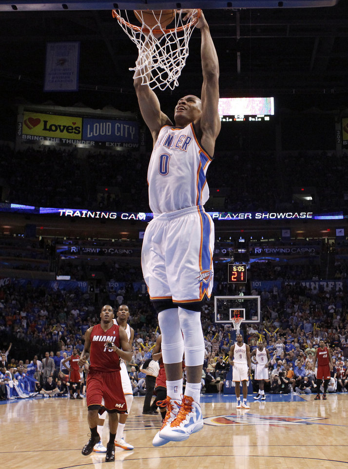 Oklahoma City's Russell Westbrook (0) dunks during the NBA basketball game between the Miami Heat and the Oklahoma City Thunder at Chesapeake Energy Arena in Oklahoma City, Sunday, March 25, 2012. Photo by Sarah Phipps The Oklahoman