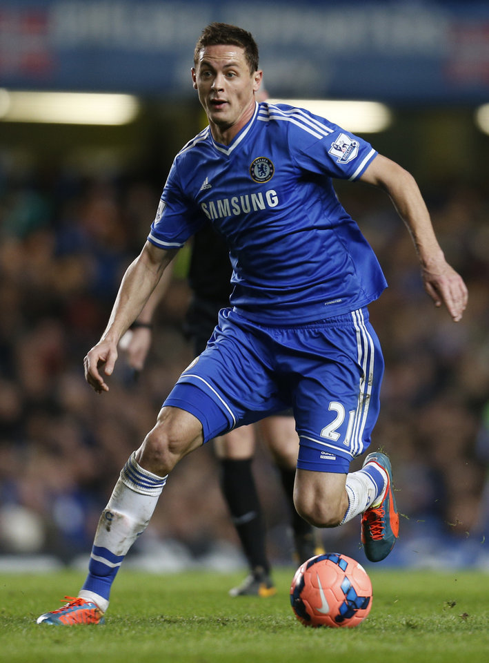 Photo - Chelsea's newly-signed player Nemanja Matic, controls the ball during an English FA Cup 4th round soccer match against Stoke City at the Stamford Bridge ground in London, Sunday, Jan. 26, 2014. Chelsea won the match 1-0. (AP Photo/Lefteris Pitarakis)