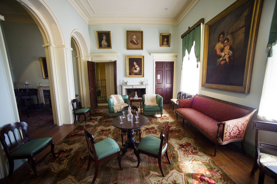 Photo - A room in the historic Arlington House at Arlington National Cemetery is seen in Arlington, Va., Thursday, July 17, 2014. The historic house and plantation originally built as a monument to George Washington overlooking the nation's capital that later was home to Confederate Gen. Robert E. Lee and 63 slaves will be restored to its historical appearance after a $12.3 million gift from Philanthropist David Rubenstein. (AP Photo/Cliff Owen)