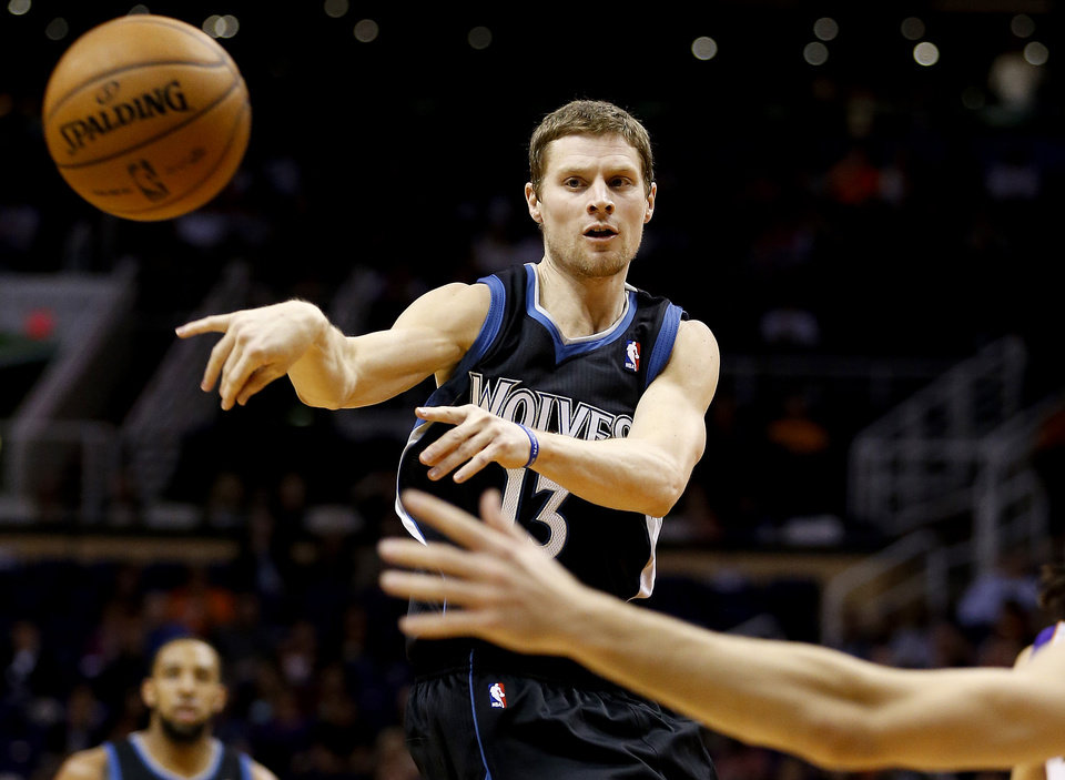 Minnesota Timberwolves\' Luke Ridnour (13) passes against the Phoenix Suns during the first half of an NBA basketball game, Tuesday, Feb. 26, 2013, in Phoenix. (AP Photo/Matt York)