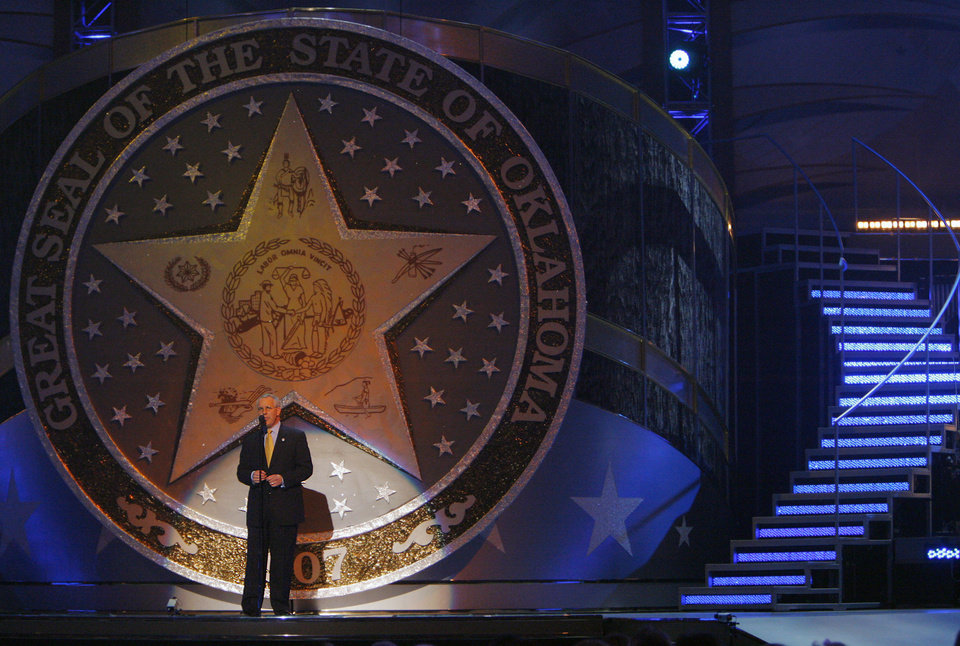 Photo - Gov. Brad Henry takes the stage during the Centennial Spectacular to celebrate the 100th birthday of the State of Oklahoma at the Ford Center on Friday, Nov. 16, 2007, in Oklahoma City, Okla. Photo By CHRIS LANDSBERGER, The Oklahoman