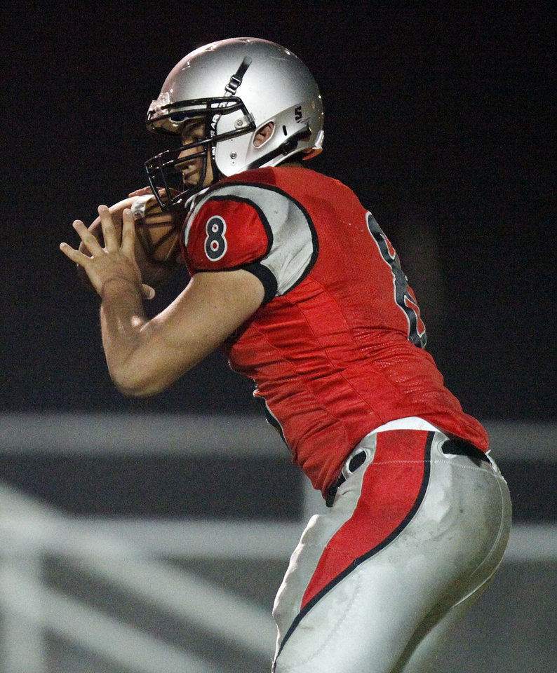 Carlos Morales (8) looks to pass for U.S. Grant during a high school football game between Ada and U.S. Grant at C.B. Speegle Stadium in Oklahoma City, Friday, Sept. 16, 2011. Photo by Nate Billings, The Oklahoman