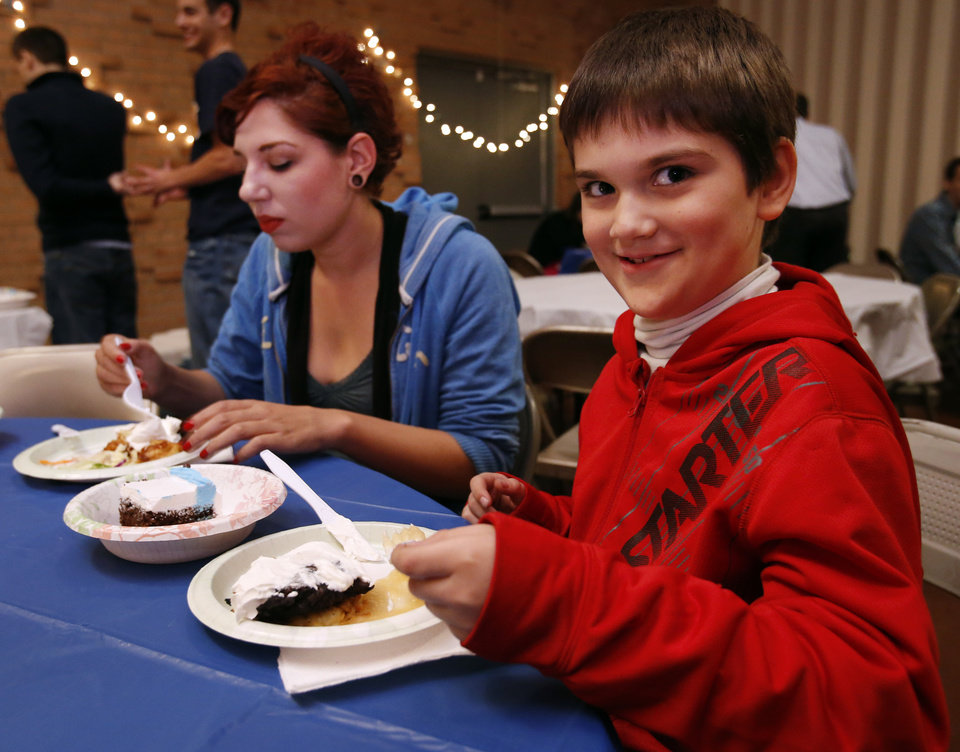Ashley Skinnell and Aiden Walton, 8, eat latkas made by University of Oklahoma students at the Hillel foundation's Latkas for Love annual fundraiser on Thursday, Nov. 29, 2012, in Norman, Okla.  Photo by Steve Sisney, The Oklahoman