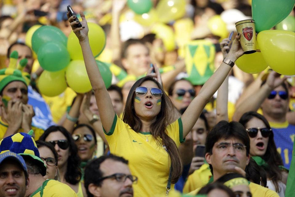 Photo - A brazil fan cheers before the World Cup quarterfinal soccer match between Brazil and Colombia at the Arena Castelao in Fortaleza, Brazil, Friday, July 4, 2014. (AP Photo/Hassan Ammar)