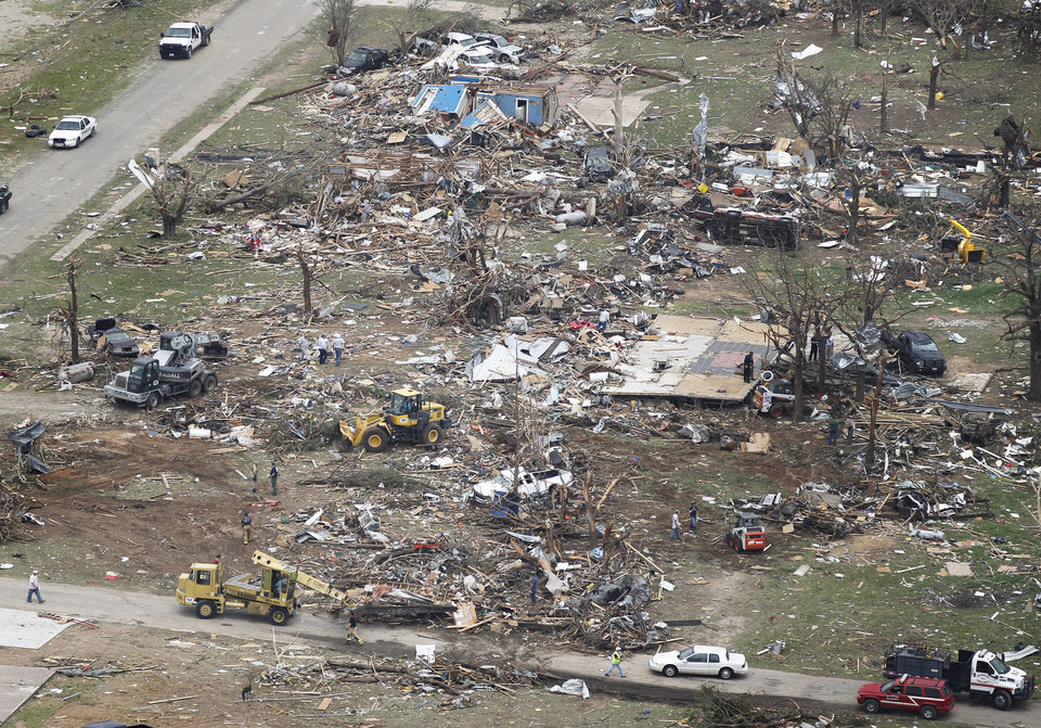 Photo - Emergency workers go through the rubble of heavily damaged homes in Granbury, Texas on Thursday May 16, 2013.  Ten tornadoes touched down in several small communities in North Texas overnight, leaving at least six people dead, dozens injured and hundreds homeless.  (AP Photo/Star-Telegram,Ron T. Ennis)  MAGS OUT; (FORT WORTH WEEKLY, 360 WEST)