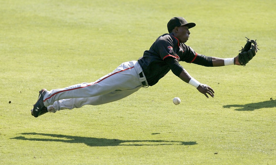 Texas Tech's Jamodrick McGruder misses the ball in the third inning of a Big 12 baseball championship tournament game between Missouri and Texas Tech at the Bricktown Ballpark in Oklahoma City, Saturday, May 29, 2010.  Photo by Bryan Terry, The Oklahoman