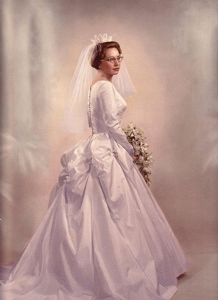 Photo - WEDDING DRESS: Carolee Wende had three requests when she was picking out the dress she would wear for her Dec. 22 wedding in 1965. Wende did not want a lace or froufrou dress, she said. This wasn't difficult because couples were starting to rebel and brides didn't want to wear lace anymore. She also wanted a dress with buttons down the back and a neckline that worked with a family pendant. Photo provided by Carolee Wende  Photo provided by Carolee Wende - Photo provided by Carolee Wende